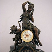 A French 3rd Republic marble and spelter mantel Clock.