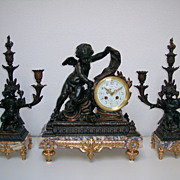 A French period 1880 marble and spelter (patina) garniture.