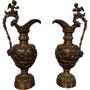 A Pair of Antique French Patinated Bronze Ewers with Bacchanalian Scenes