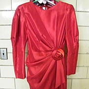 Red Taffeta Sheath With Side Pleated draped Peplin & Self Rose Flower At Waist..By La Cadence