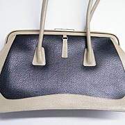 DESIGNER..Handbag By SUARAZ..Dark Navy Textured Leather With Beige Textured Leather Outline..A