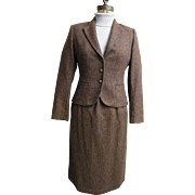 Wool Checked Chesterfield Suit..Fitted Jacket..Stright Skirt With Lightly Gathered Waist..Calf