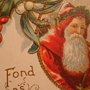 SALE Early 1900's Embossed Christmas Postcard Framed Santa, Holly Leaves & Berries