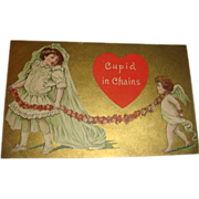 SALE Cupid in Chains 1910 Valentine Postcard Little Girl Bride Pulls Cupid by Chain of Flowers