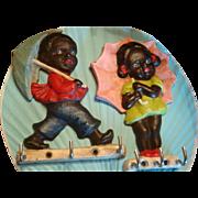 Pair Black Americana Umbrella Girl and Boy Key or Hot Pad Holder Cast Iron Children ...