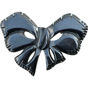 Carved Black Bakelite Bow Pin