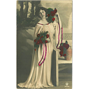 Tinted Photo Postcard of Lady in White with Red Roses 1909