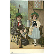 SALE Embossed and Silk Embellished Postcard of Two German or Austrian Children with Rifle