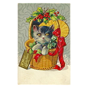 Embossed 1913 Christmas Postcard with Cat in Wicker Basket