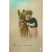 SOLD French Postcard of Young Child with German Shepherd Dog - New Year