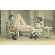 SALE Undivided Tinted Photo Postcard of Young Boy and Girl with Doll Playing House