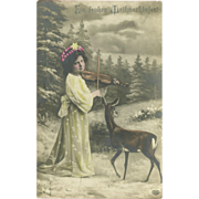 SALE German Christmas Tinted Photo Postcard of Girl and Deer