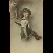 Tinted 1912 Photo Postcard of Young Girl with Rake