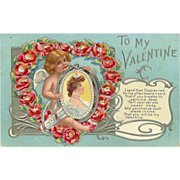SALE Embossed 1909 Valentine Postcard of Cherub with Lady