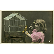 French Tinted Photo Postcard of Young Girl with Bird