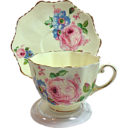 Paragon Double Warrant Pale Yellow Ground Pink and Blue Florals Display Cup and Saucer