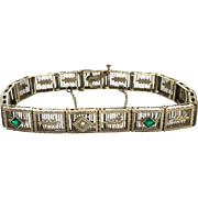 Art Deco 10 Karat White Gold Filigree Articulated Wide Bracelet with Diamond and Emeralds