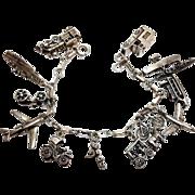 SALE Fun vintage sterling silver travel vehicle charm bracelet