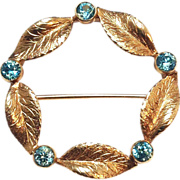 SALE 1940s 14K Yellow Gold wreath pin with Blue Stones and Leaf Pattern