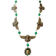 SALE Egyptian design Gold Tone with small green plastic beads and Large glass pendent