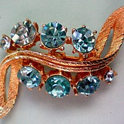 SALE Rhinestone Swirl Brooch with Blue Stones