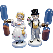 ITEM DESCRIPTION: Cpurting Couple, Antique Germany Egg Timers. Courting couple. The boy is hol