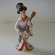 Oriental Woman Playing Instrument Figurine