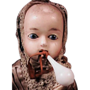 Rare Semi Mechanical Wax Over Papier Mache Baby Doll with Original Glass Bottle and Dress