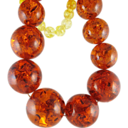 Dramatic Vintage 26-Inch Pressed Amber Graduated Bead Necklace With 1 Inch Center Bead