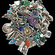 Vintage Southwestern Theme Sterling Silver Charm Bracelet 58 Charms - 152 Grams