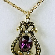 Signed Avon Amethyst Colored Rhinestone Pendant with Chain