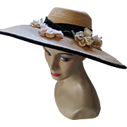 Wide Brim Vintage Straw Hat with Profusion of Peach Tone Flowers and Black Velvet Ribbon