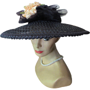Sophisticated Black Straw Hat Picture Style with Open Work and Clutch of Peach Roses Mid ...
