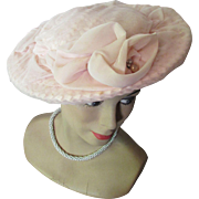 SALE Wide Brim Hat in Cameo Pink Cellophane Weave Draped in Net Decorated with Two Net Roses