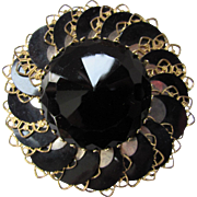 Round Vintage Brooch with Black Faceted Center and Sequin Whorls