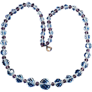 Heavier faceted clear crystal round bead necklace mauve spacers
