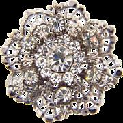 Classic vintage rhinestone brooch in a silver tone finish