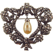 Vintage floral brooch with marcasites and dangling imitation pearl