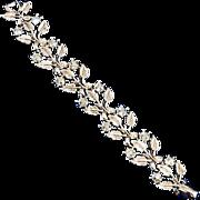 Floral & rhinestone blue AB link bracelet gold tone base