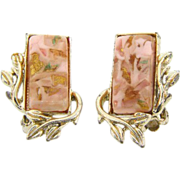 Signed Coro gold tone clip on earrings with light pink lucite insert