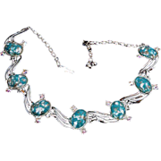 Necklace adjustable with mottled Turquoise cabs AB stones