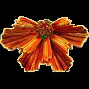 Signed Weiss bright burnt orange enamel Brooch with rhinestone ball