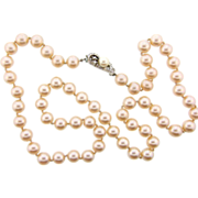 Signed Richelieu 24 inch single strand of champagne colored glass imitation pearl Necklace wit