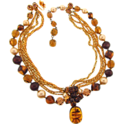 Signed DeMario 5 strand choker Necklace with center bead cluster and large amber glass drop