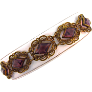 Beautiful antiqued gold tone link bracelet with amethyst glass stones