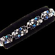 Signed Lisner floral link Bracelet with shades of blue rhinestones