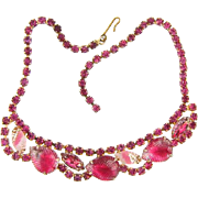 Bright pink vintage rhinestone Choker Necklace with molded leaves and givre stones in a gold t