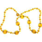Signed Miriam Haskell bright yellow 28 inch long  bead Necklace with gold tone filigree ...
