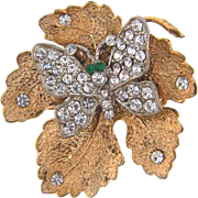 Vintage gold tone leaf topped with crystal  rhinestone butterfly Brooch