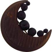 Early carved wood with black jet crescent moon Brooch